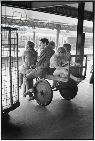 Family on a cart at a railway station (b/w photo)