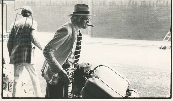 David Hockney arrives at London Airport, October 1974 (b/w photo)