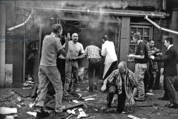 Soho nail bomb: the first casualties emerge dazed from the blast, Admiral Duncan Pub, Old Compton Street, London, 30th April 1999 (b/w photo)