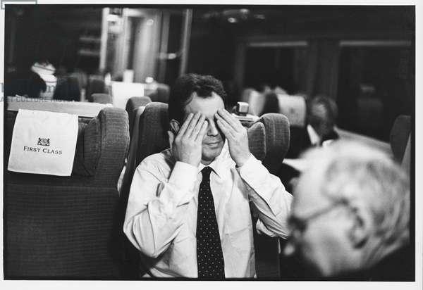 Tony Blair on a train, 1995 (b/w photo)