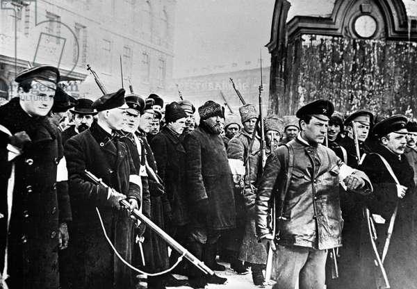 Insurgents escort disguised policemen, 1917 (b/w photo)
