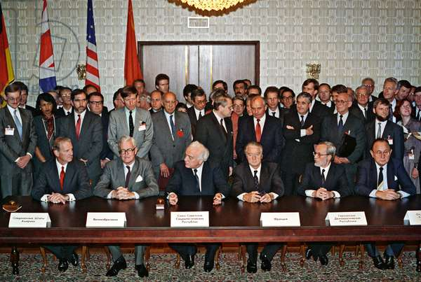 The Foreign Ministers of six countries, the Soviet Union, the United States, the United Kingdom, France, the German Democratic Republic and the Federal Republic of Germany, sign the treaty for the unification of both German states in the presence of U.S.S.R. President Mikhail Gorbachev, Moscow, 12th September 1990 (photo)