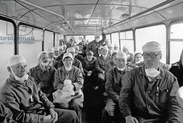 Group of decontamination specialists makes for the site of the Chernobyl Nuclear Power Plant accident, which happened on April 26, 1986, 1986 (photo)