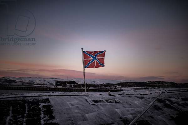 A flag flutters above the Yury Dolgoruky nuclear ballistic missile submarine of the Russian Navy's Northern Fleet in Gadzhiyevo in the Murmansk Region, 2014 (photo)