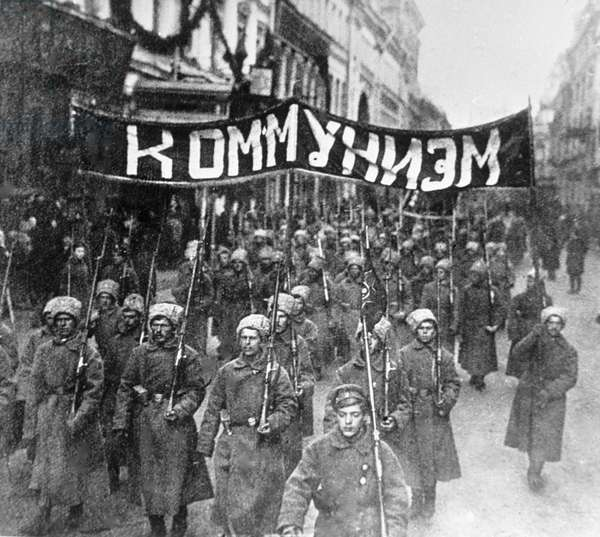 Column of soldiers with a banner in Nikolskaya street , 1917 (b/w photo)