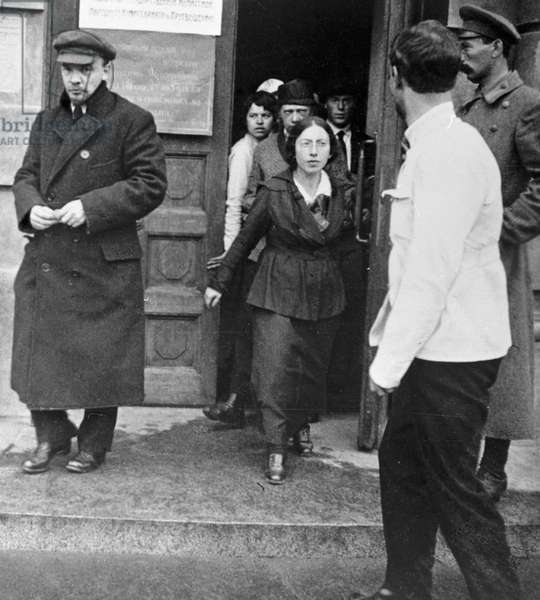 Lenin leaves congress session, 1918 (b/w photo)