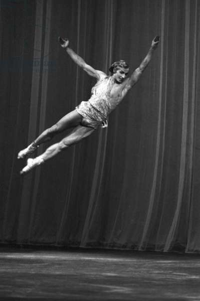 I International Ballet Competition, Soviet artist, gold medal winner at the competition Yuri Vladimirov performs a pas de deux from La Esmeralda ballet by Cesare Pugni, 1969 (b/w photo)