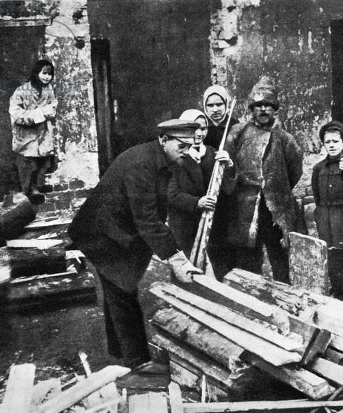 Giving out wood during the Civil War, 1919 (b/w photo)