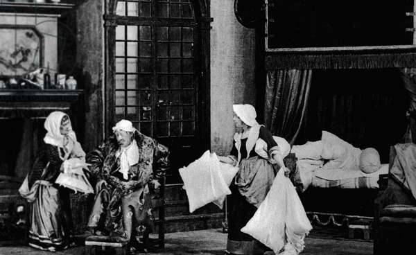 Russian actors Olga Knipper-Chekhova as Beline (left), Konstantin Stanislavsky as Argan (center) and Maria Lilina (right) as Toinette in Moliere's comedy 'Imaginary Invalid', Moscow Art Theatre, 1913 (b/w photo)