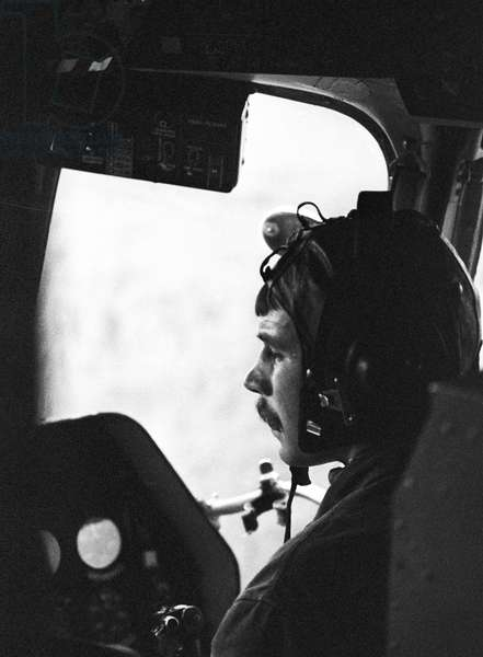 Measuring the radiation level from a helicopter. Inside the cockpit, 1986 (photo)