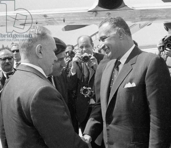 Chairman of the U.S.S.R. Council of Ministers Alexei Kosygin (left) meeting with Egyptian leader Gamal Abdel Nasser at the airport, 1970 (b/w photo)