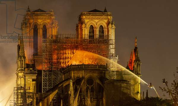 15.04.2019 Firefighters douse flames from the burning Notre Dame Cathedral in Paris, France (photo)