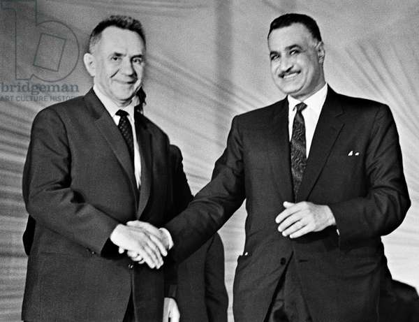 Alexei Kosygin, USSR Council of Ministers Chairman (Prime Minister), left, and Egypt's President Gamal Abdel Nasser, right, at a Soviet-Arab friendship rally, Aswan, 1966 (b/w photo)