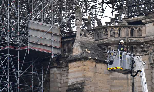 16.04.2019 Firefighters control after all the fire has been extinguished at the Notre Dame Cathedral in Paris, France. The landmark Cathedral was partially destroyed by major fire that broke out on Monday evening (photo)