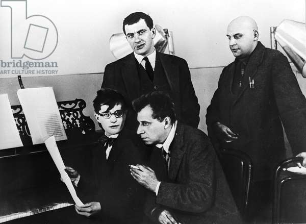 "Dmitry Shostakovich, Vsevolod Meyerhold (sitting), Vladimir Mayakovsky and Alexander Rodchenko (standing), working on the play ""The Bedbug"" (b/w photo)"