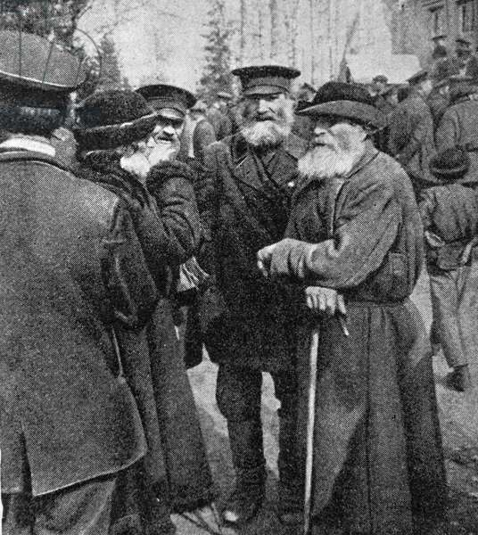February Revolution discussed by peasants, 1917 (b/w photo)