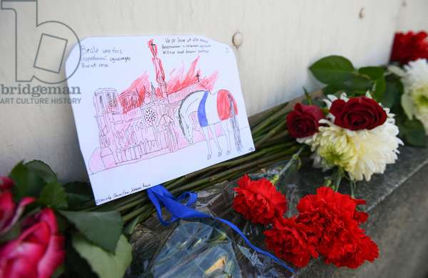 16.04.2019 Flowers are laid next to the French Embassy in Moscow, Russia, as Russians commisirate with Parisians after Notre Dame Cathedral was partially destroyed by major fire that broke out on Monday evening (photo)