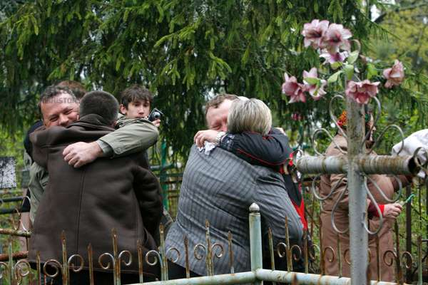 People visiting cemetery on the Day of Rejoicing at the Pogonnoye Village, contaminated Polesskoye area, they deserted after the Chernobyl disaster, 2011 (photo)