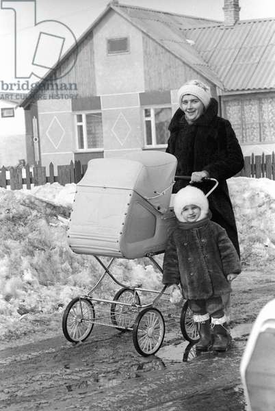Olga Labukha on one of the streets of the settlement of Nebrat built for the refugees from Chernobyl after the accident occurred on the nuclear power plant on April 26, 1986, 1987 (photo)