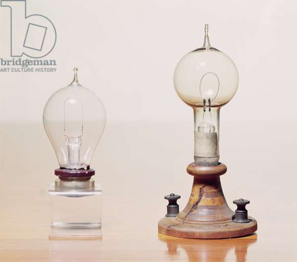 Early light bulbs: left: first commercial light bulb, right: electric filament lamp made by Thomas Alva Edison (1847-1931) in 1879 (glass & wood)