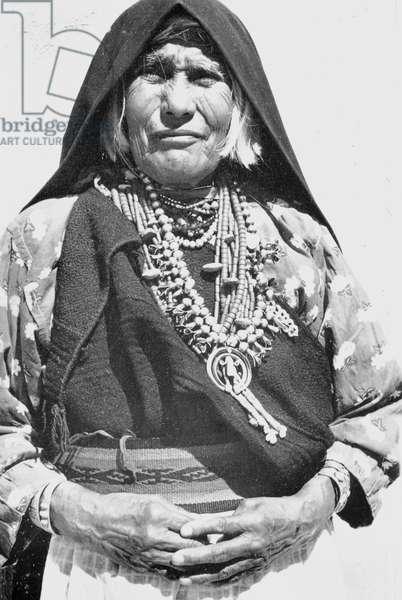 Pueblo woman and squash blossom, 1930 (b/w photo)