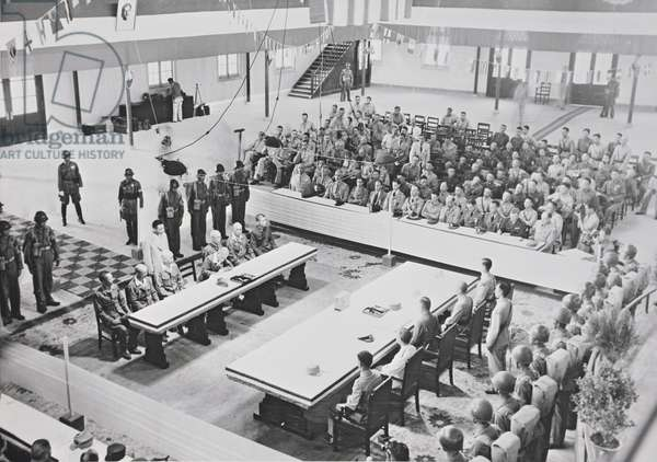 General Okamura Yasutsugu, Commander of the Japanese Forces in Central China signs the Act of Surrender, Nanking, 9 September 1945 (b/w photo)
