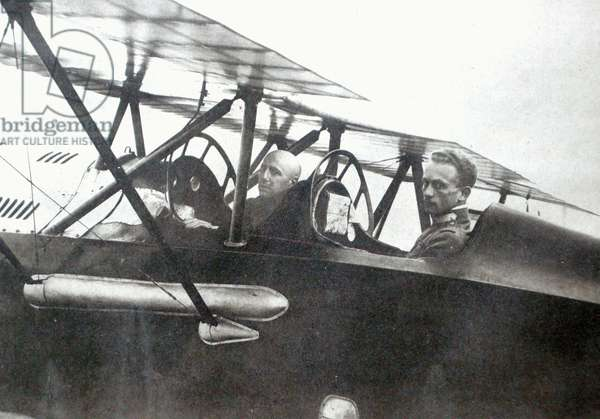 Gabriele d'Annunzio flying with his pilot to drop leaflets over Vienna, 1918 (b/w photo)