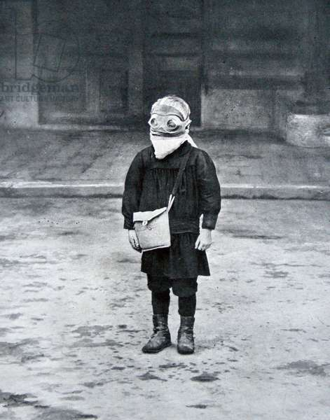 French schoolboy wearing a gas mask, 1916 (b/w photo)