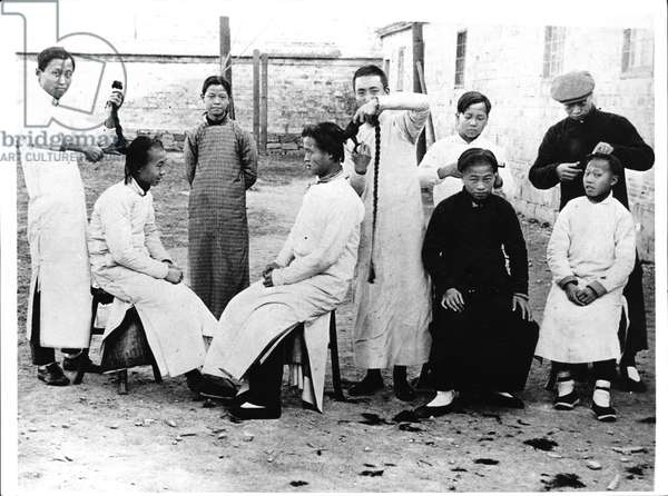 Men having their hair cut at the time of the 1912 Revolution (b/w photo)