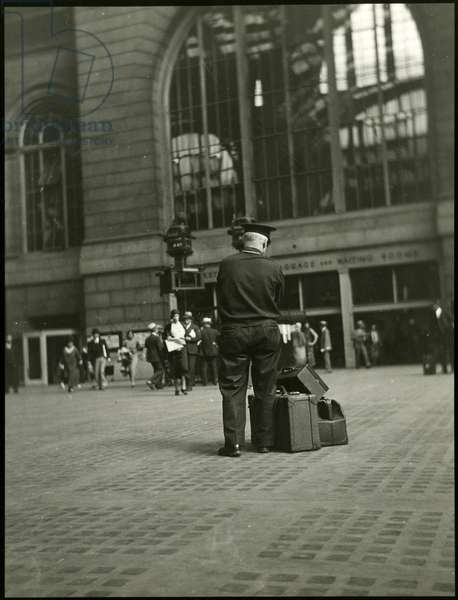 Penn Station, 7th Avenue: Porter watching luggage, USA, c.1920-38 (gelatin silver photo)