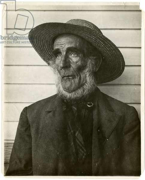 Old man in straw hat, c.1905-40 (gelatin silver photo)