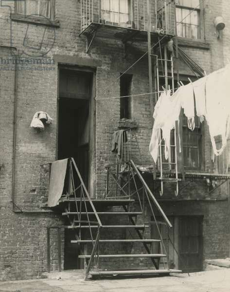 Laundry and stairway to rear building entrance, Lower East Side, New York, USA, c.1920-38 (gelatin silver photo)