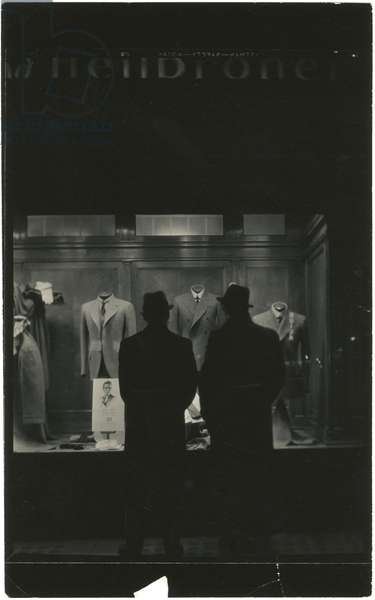 Two men silhouetted in front of Weber and Heilbroner window display, 503 Fifth Avenue, New York, USA, c.1920-38 (gelatin silver photo)