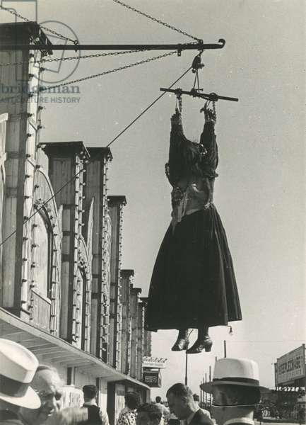 Coney Island boardwalk, mannequin hanging outside an attraction, New York, USA, c.1920-38 (gelatin silver photo)