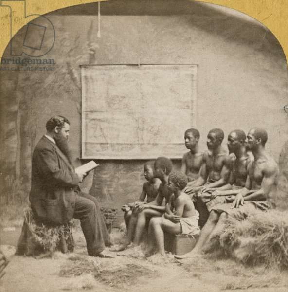 White man reading to a group of African-American men and boys (albumen print)