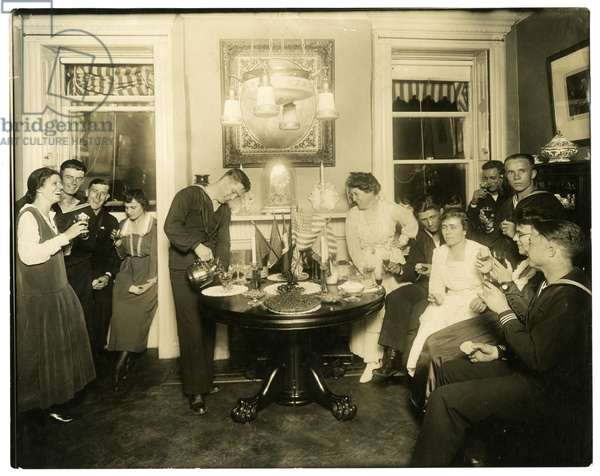 Alice Foote MacDougal entertaining a group of sailors in her small apt in Old War, Greenwich Village, New York, USA, c.1917-18 (gelatin silver photo)