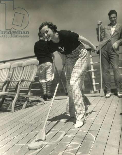 Shuffleboard on ship's deck, USA, c.1920-38 (gelatin silver photo)