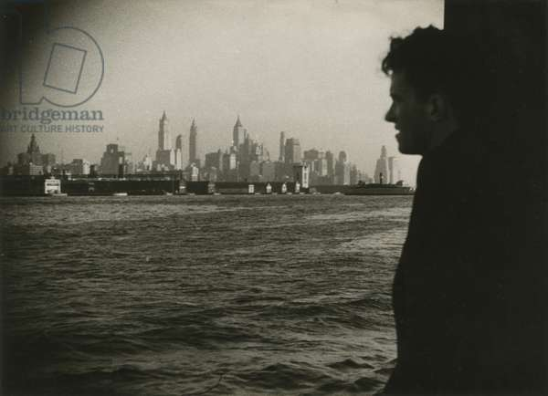 Man looking at Manhattan skyline from boat, New York, USA, c.1920-38 (gelatin silver photo)
