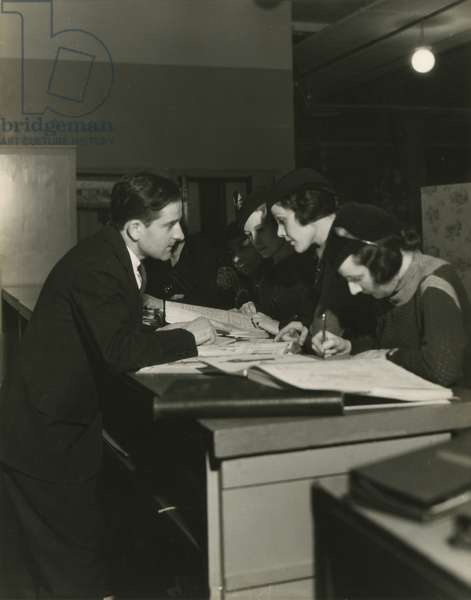 Women looking through catalogues or pattern books, New York, USA, c.1920-38 (gelatin silver photo)
