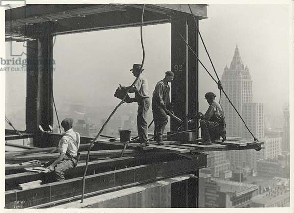 Riveters attaching a beam, Empire State Building, 1931 (gelatin silver print)