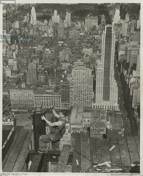 A worker at the edge of a platform, looking north, Empire State Building, 1931 (gelatin silver print)