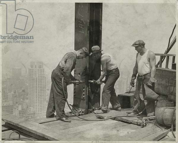 Three workers securing a rivet, Empire State Building, 1931 (gelatin silver print)