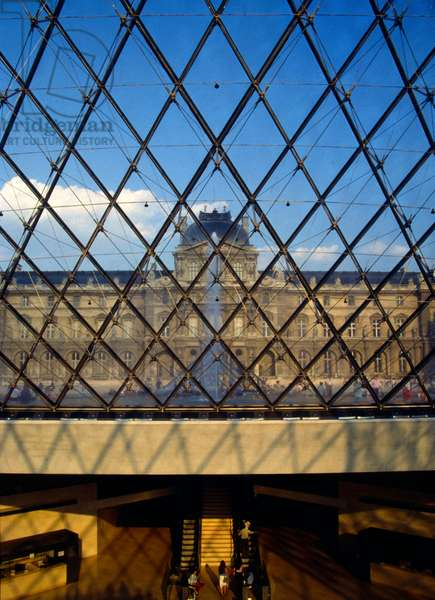 View of the Louvre from the interior of the glass pyramid, Paris, France (photo).