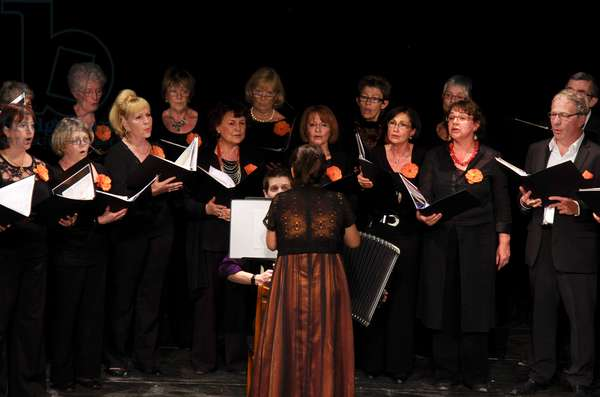Mixed adult choir with female conductor