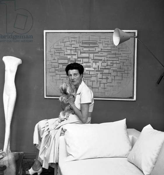 Peggy Guggenheim, American art collector, with Giacometti sculpture and Mondrian painting, Venice, 18th September 1957