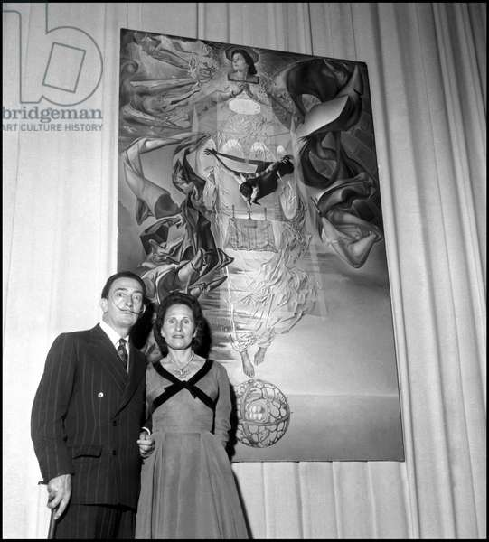 Salvador Dali posing with his wife Gala, during the installation of his exhibition at Palazzo Pallavicini Rospigliosi, Rome, 29/04/1954 (b/w photo)