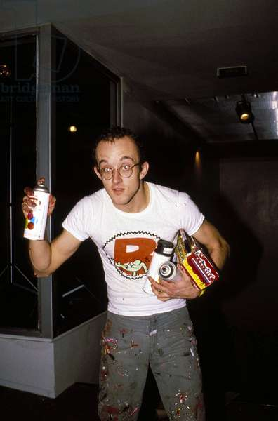 Portrait of Keith Haring drawing in the subway 1984