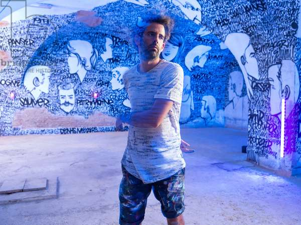 Portrait of Denis Meyer (urban artist) in front of his work at Mausa (Musees des Arts Urbains et du Street Art) 07/07/2018