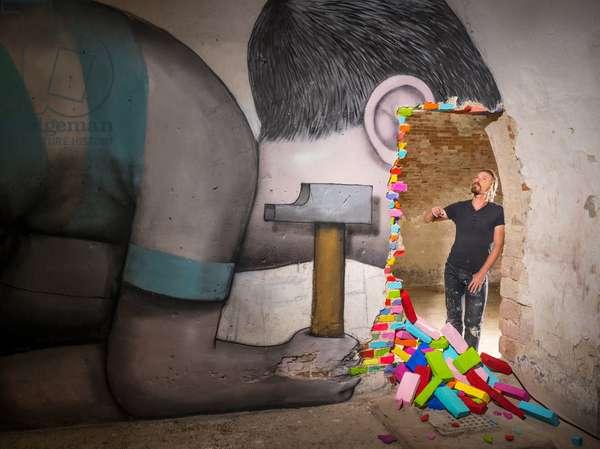 Portrait of Julien Malland (urban artist) (aka Seth) in front of his work at Mausa (Musees des Arts Urbains et du Street Art) 08/07/2018