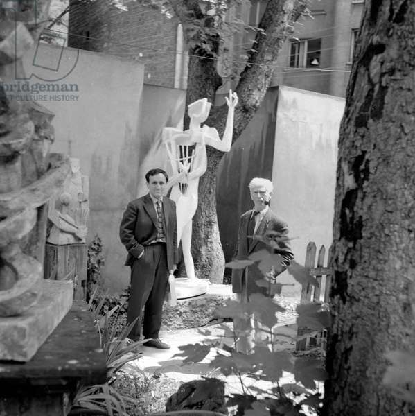 Portrait of the sculptor Ossip Zadkine (1890-1967) in his parisian house 1956 (b/w photo)